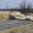 Wood by a cement foundation for a new home construction — Stockfoto