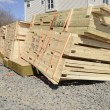 Stack of new lumber ready for a new home construction — Stock Photo