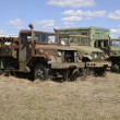 Three old army vehicles parked in a grass field — Stock Photo