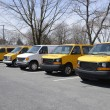 Row of school vans - Stock Photo