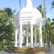 White gazebo by a beach — Stock Photo