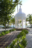 White gazebo by a beach — Foto Stock