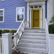 Blue house with yellow door — Stock Photo