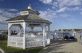White gazebo by a harbor in the early morning — Stock Photo