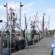 Stock Photo: Commercial fishing boats by a wood dock