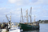 Commercial fishing boats in a harbor — Stock Photo