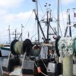 Commercial fishing boats by a wood dock — Stock Photo