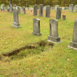 Sunken grave in an old cemetery — Stock Photo