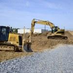 Backhoe and bulldozer — Stock Photo