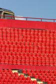 Seats red at stadium — Stock Photo