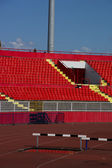 Seats red at stadium — Stok fotoğraf