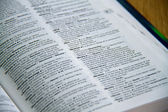 Dictionary Open at Definition of Library — Stock Photo