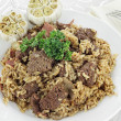 Venison Pilaf and Roasted Garlic Cloves — Stock Photo