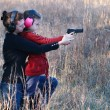 Stock Photo: Mom and Daughter Practicing Shooting