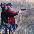 Mom and Daughter Practicing Shooting - Stock Photo
