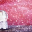 Stock Photo: Snowglobe Against Red