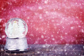 Snowglobe Against Red — Stock Photo