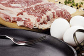 Frying Pan with Fresh Eggs and Bacon — Stock Photo