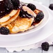 Постер, плакат: Pancakes and Blackberry Sauce