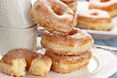 Stack of Donuts and Cups — Stock Photo