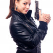 Beautiful girl in black leather jacket and beretta gun in her hands isolated on white background — Stock Photo #12486673