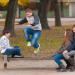 Teenage boys and girls having fun in the park on beautiful autumn day — Stock Photo #12488140