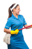 Beautiful young cleaning lady pretending to be a guitar player. — Stock fotografie