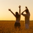 Young couple in the wheat field on sunny summer day — Stock Photo