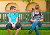 Teenage boy looking with love at indifferent teenage girl — Stock Photo