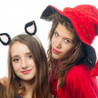 Teenage girls dressed in costumes for halloween isolated on white — Stock Photo