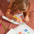 Cute blond little girl drawing on the paper — Stock Photo