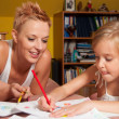 Happy mother and daughter drawing at their home — Stock Photo