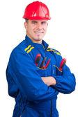 Jonge knappe mechanic met harde hoed en hulpmiddelen en in overall geïsoleerd op wit — Stockfoto