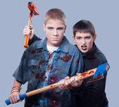 Assassinos de adolescentes de halloween isolados em cinza — Foto Stock