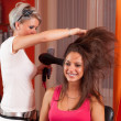 Hairdresser making hair of beautiful teenage girl — Stock Photo #13777297