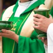 Christipriests holding bowls with wafer and wine during sacrament. — Stock Photo #14076959