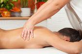 Young women getting back massage in massage salon — Stock Photo