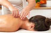 Beautiful young women getting a massage in massage salon — Stock Photo