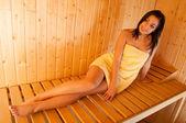 Beautiful smiling girl in sauna — Stock Photo