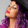 Royalty-Free Stock Photo: Portrait of beautiful sexy girl with purple hair and black hat