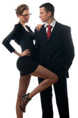 Beautiful sexy lady seducing young businessman isolated on white — Stock Photo