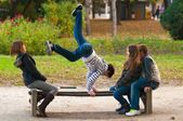 Teenagers having fun in the park on beautiful autumn day — Stock Photo
