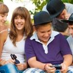 Teenage boys and girls having fun outdoor on beautiful spring day — Stock Photo