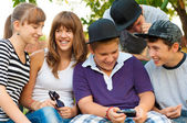 Teenage boys and girls having fun outdoor on beautiful spring day — Stock Photo