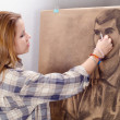 Young female artist drawing man portrait in her art studio. - 