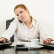 Stressed business woman multitasking in her office using latest technology. — Stock Photo