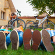 Teenagers resting on the grass — Stok fotoğraf