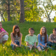 Teenage friends having fun in the nature on sunny spring day — Stock Photo