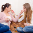 Two teenage girlfriends trying out perfumes — Stock Photo #23654433