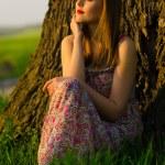 Beautiful girl watching sunset — Stock Photo #24332685